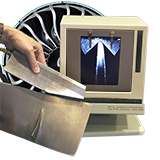 The model 900C edge profile comparator inspects aircraft engine turbine fan blades